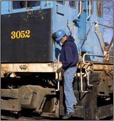 Man_on_train_steps__knee_2__medium